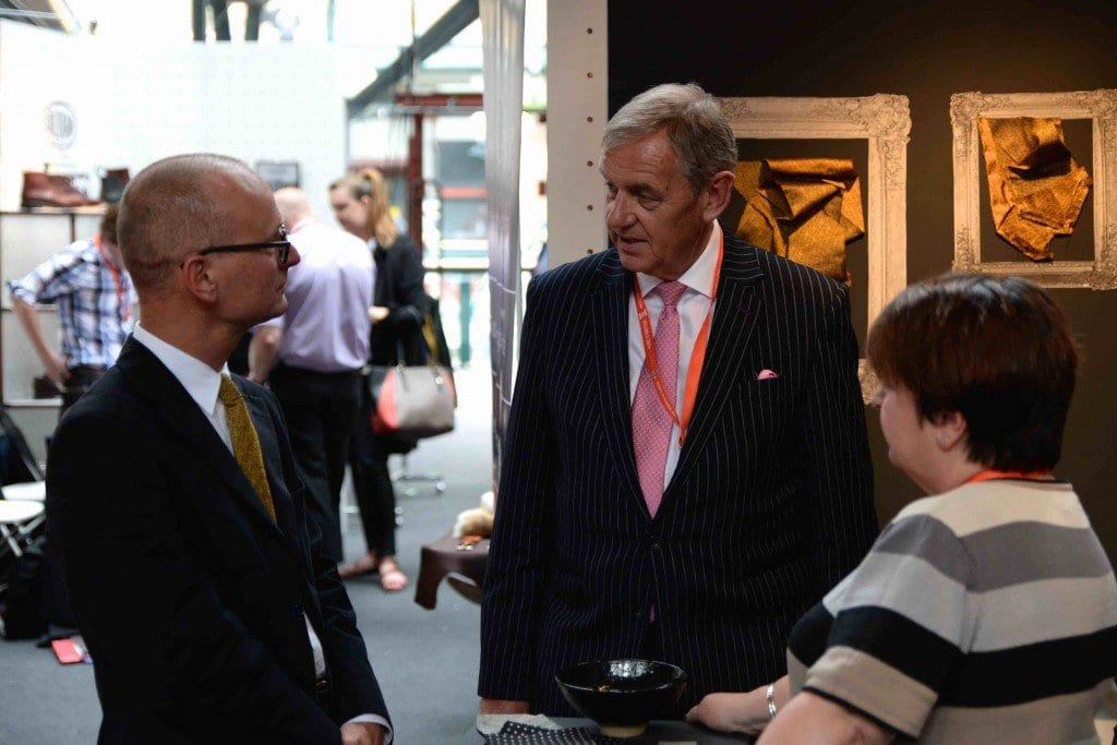 John Miln, CEO of UKFT talking business with Mustard Ties