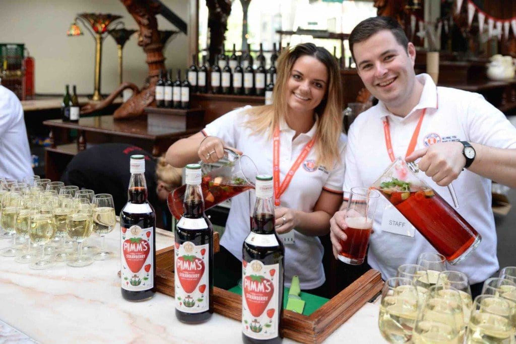 Some of our lovely staff pouring the complimentary Pimms
